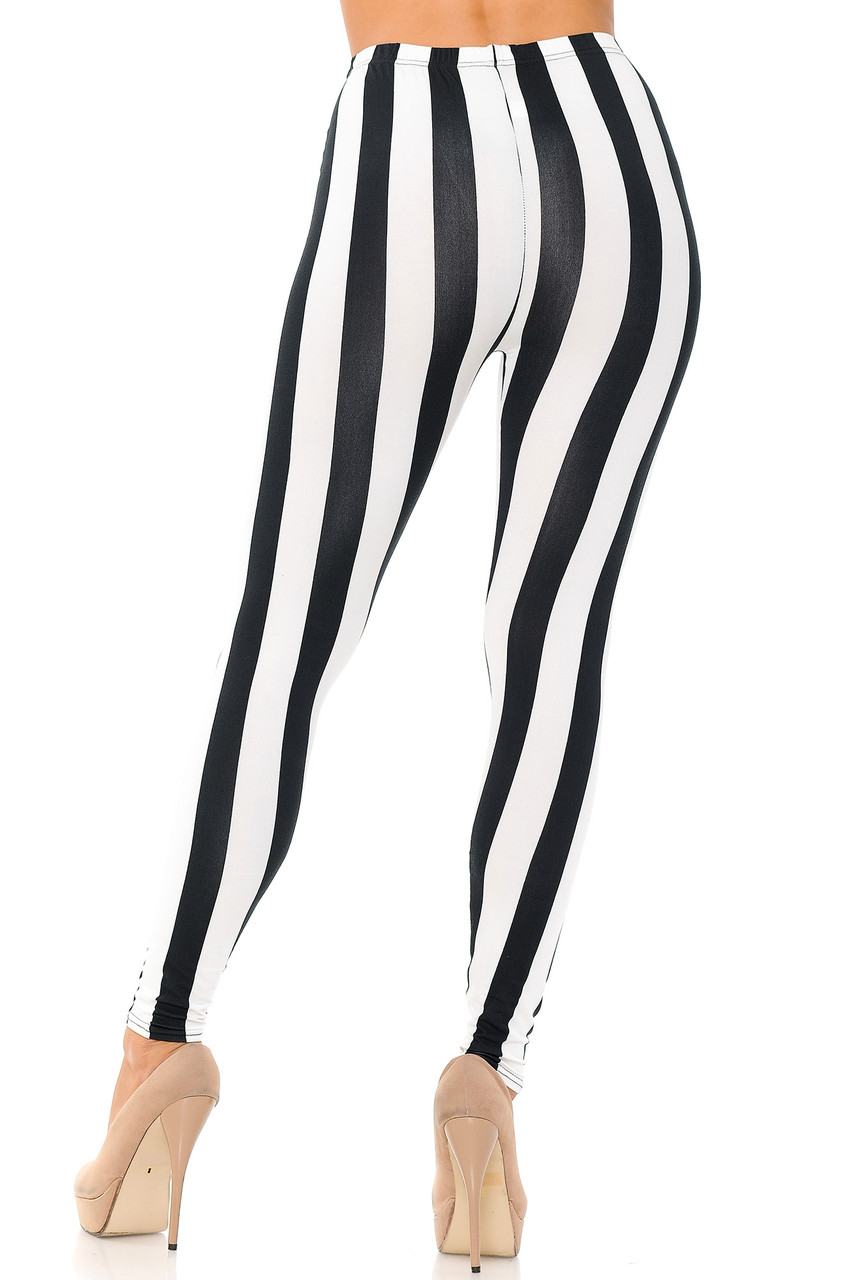 Rear view of our body fitted Buttery Soft Black and White Wide Stripe Plus Size Leggings.