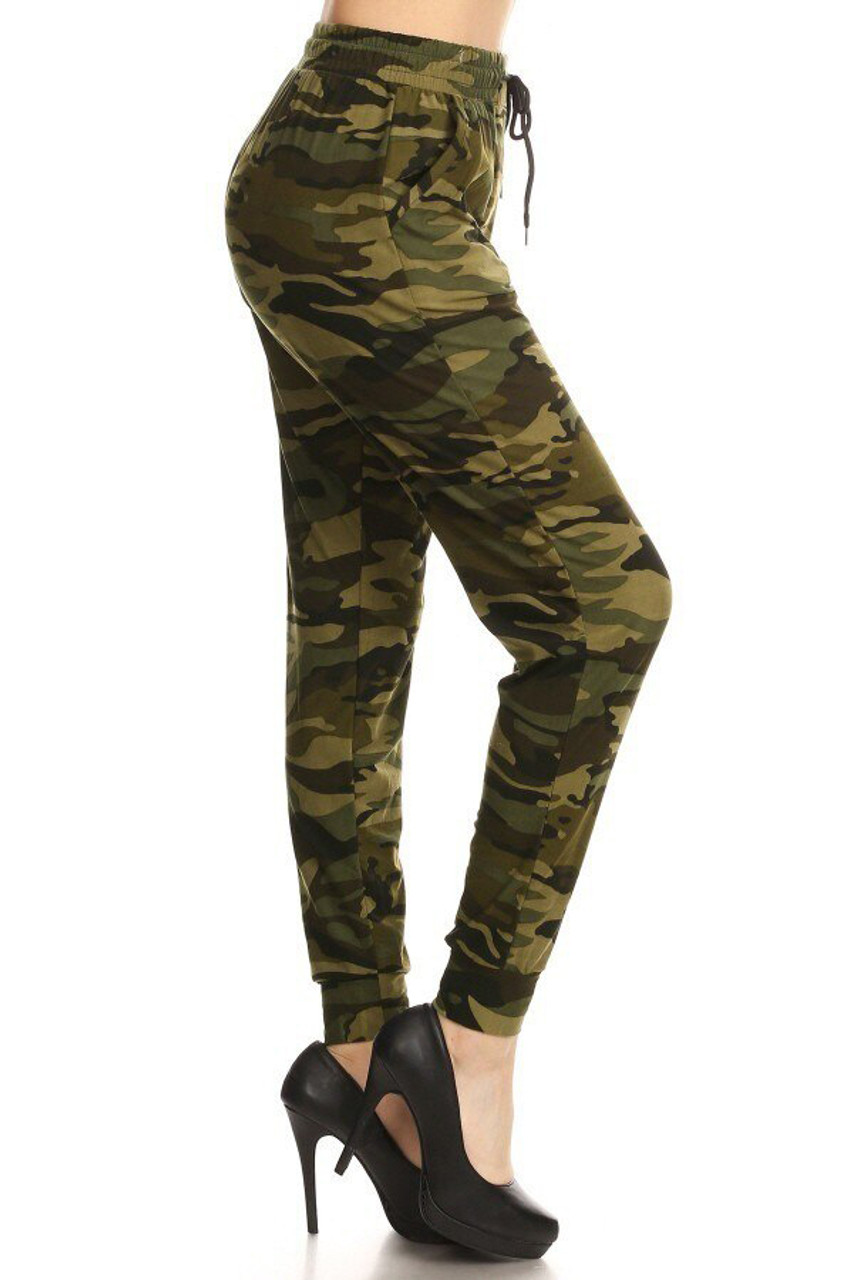 Right side view of our casual and trendy Buttery Soft Olive Camouflage Joggers featuring side pockets and an elastic tie string waist.