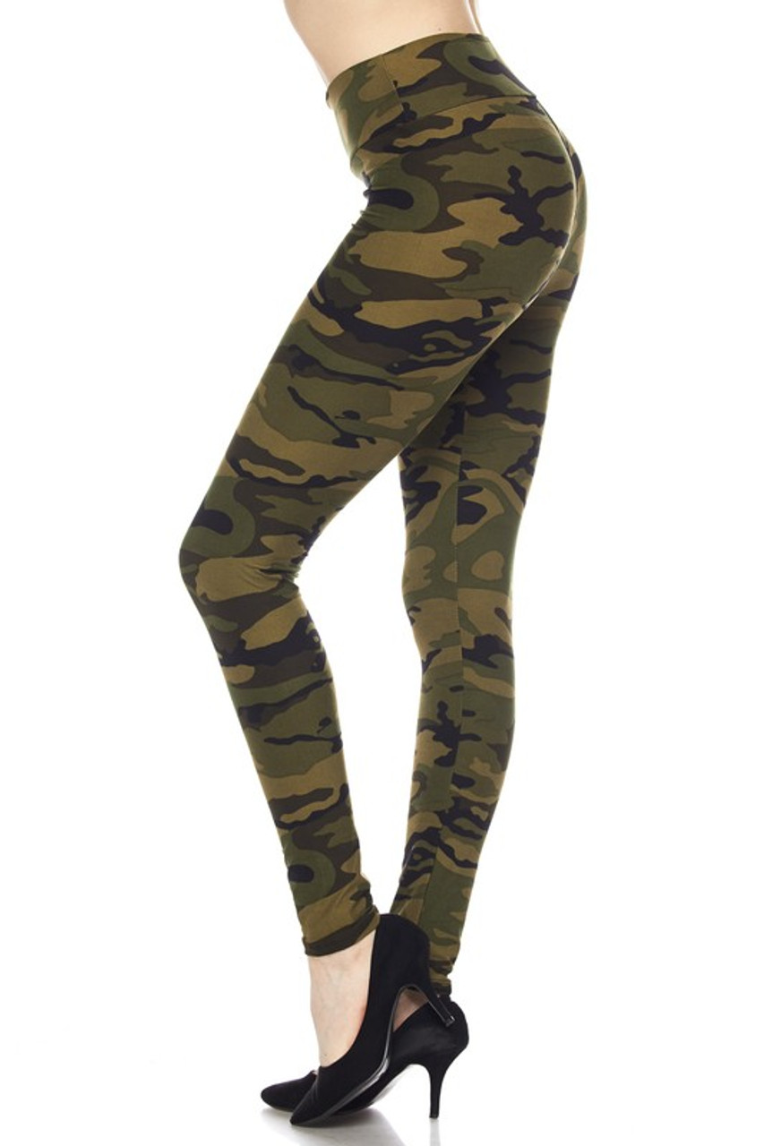 Our Buttery Soft Green Camouflage High Waist Leggings feature a classic army print design with a mixed olive color scheme.