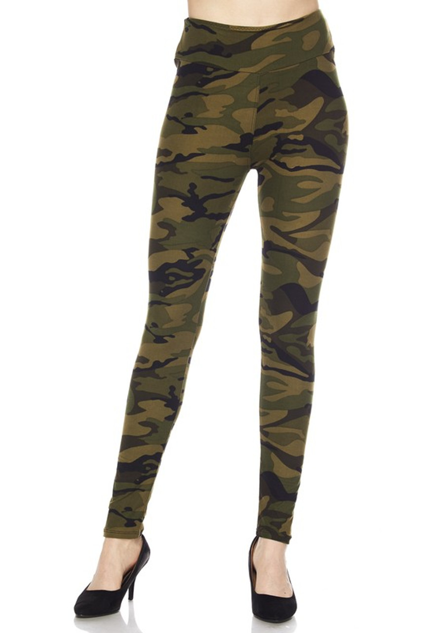 Our  Buttery Soft Green Camouflage High Waist Leggings feature a full length skinny leg cut.