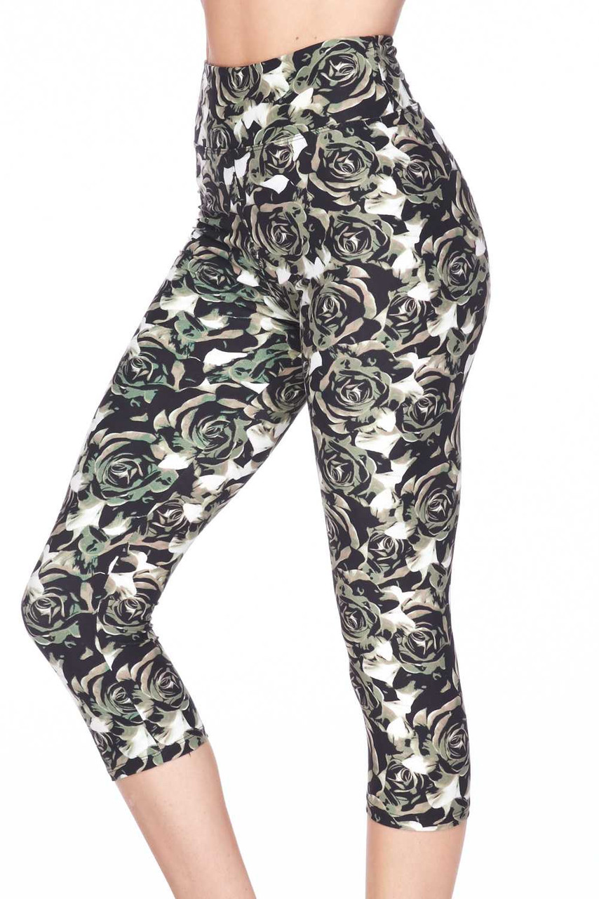 Our Buttery Soft Olive Rose Capris feature a neutral colored rose design in a muted green, beige and black color scheme with white background that subtly peeks through.