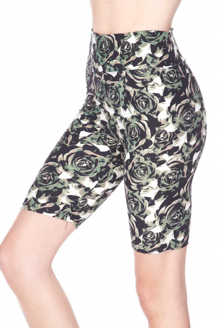 Our Buttery Soft Olive Rose Plus Size Shorts feature a neutral colored rose design in a muted green, beige and black color scheme with white background that subtly peeks through.