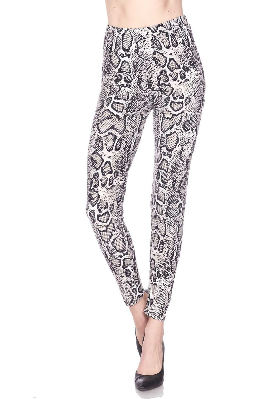 Our Buttery Soft Beige Boa Snakeskin Plus Size Leggings feature an elastic banded waist that comes up to about mid rise.