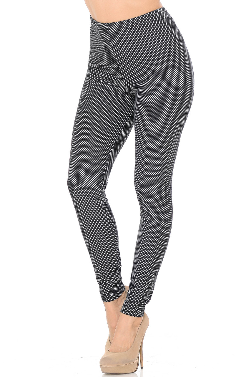 Our Buttery Soft Mini Polka Dot Plus Size Leggings feature a simple all over white on black polka dot design that pairs with a top of any color for any season.