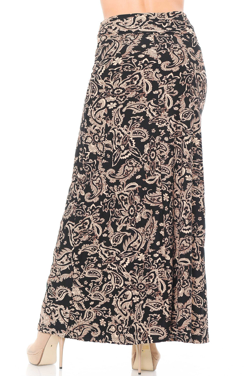 Our Buttery Soft Sand Pepper Paisley Maxi Skirt features a long length that goes below the ankle, depending on height and shoe pairing.