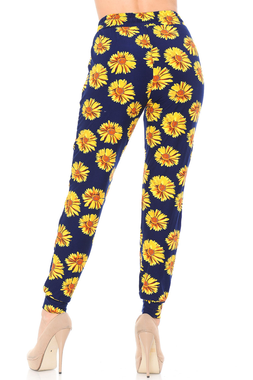Rear view image of our loose fit Buttery Soft Summer Daisy Joggers that feature tapered ankles.