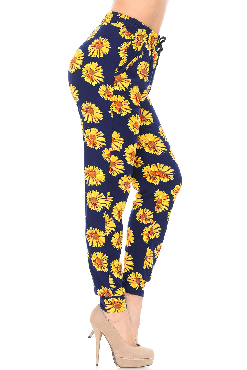 Right view side leg image of our Buttery Soft Summer Daisy Joggers featuring convenient side pockets.