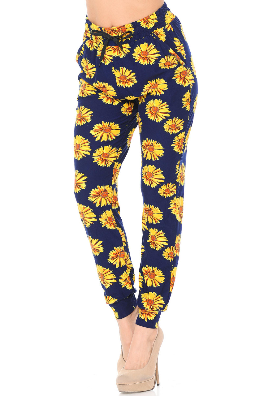 Partial front view image of our Buttery Soft Summer Daisy Joggers with an elastic and tie string waist.a