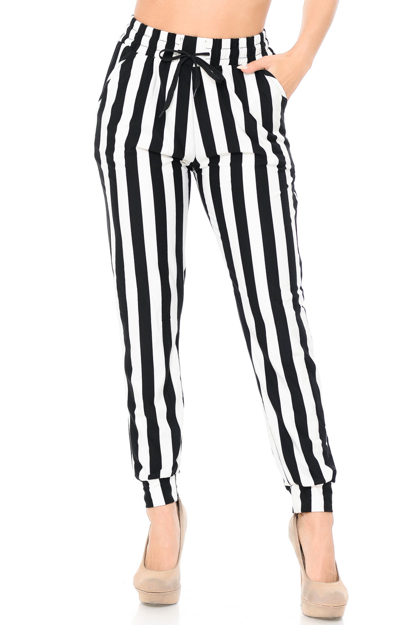 Our Buttery Soft Black and White Wide Stripe Joggers feature a flattering vertical striped design.