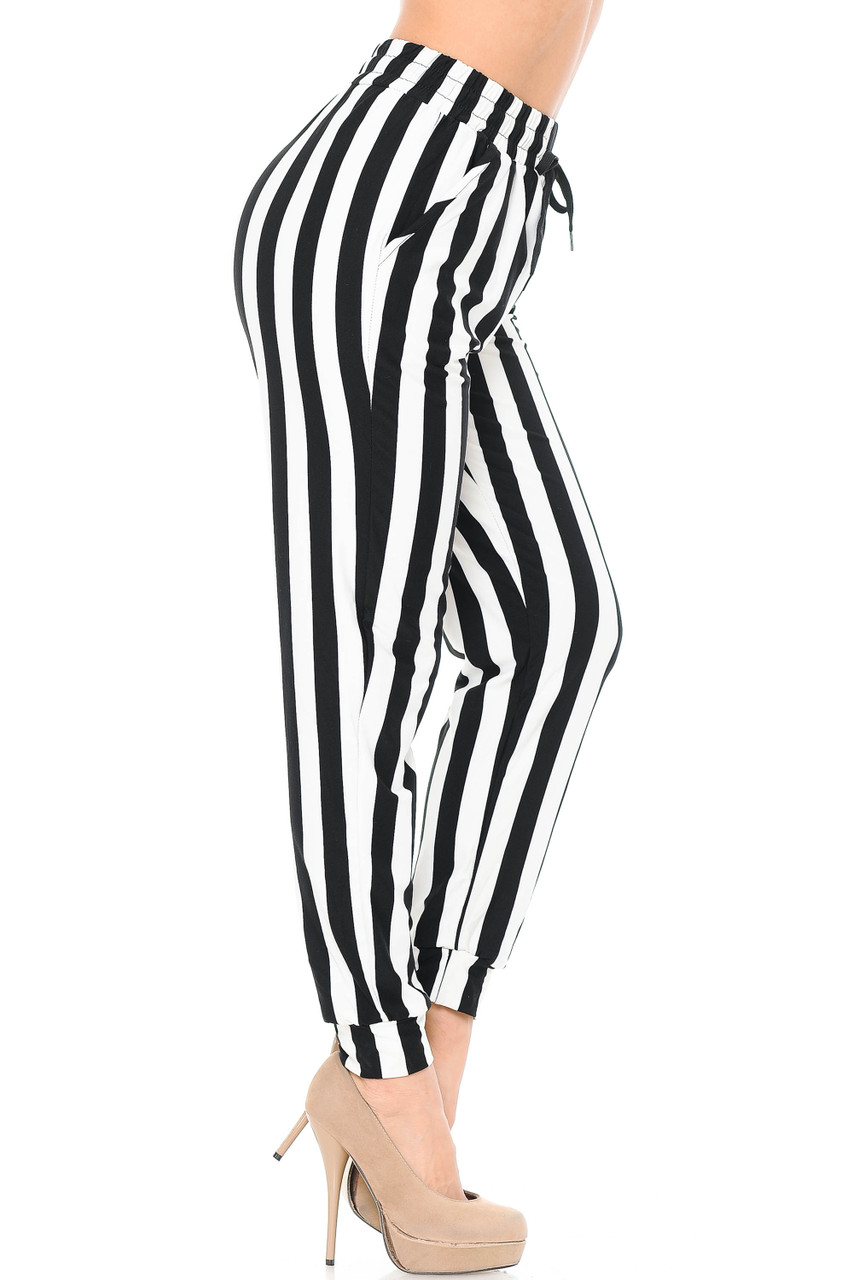 Right side leg image of our Buttery Soft Black and White Wide Stripe Joggers with a looser fit and tapering at ankle cuffs.