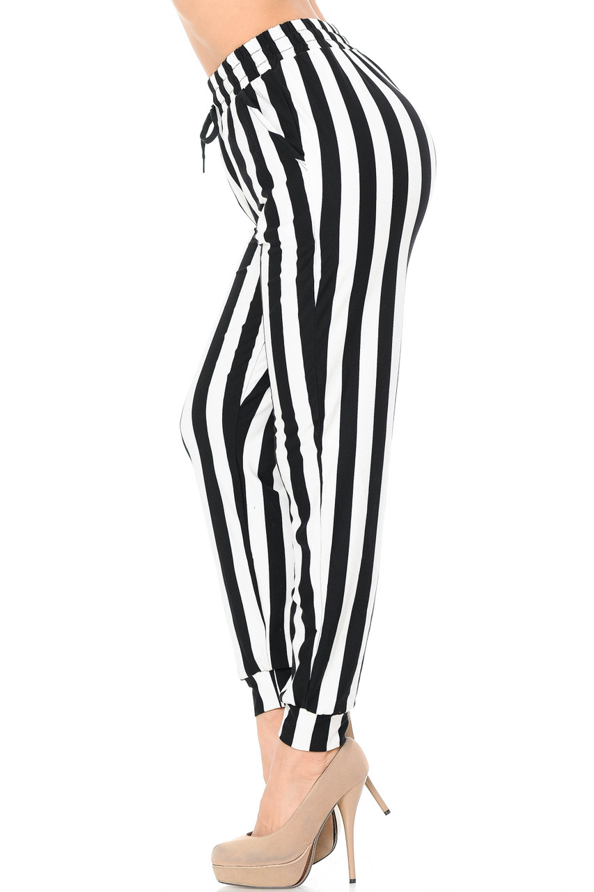 Left side view image of our Buttery Soft Black and White Wide Stripe Joggers featuring a neutral color scheme that will pair with a top of any color.