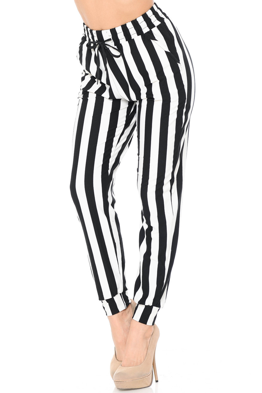 Angled front view image of our Buttery Soft Black and White Wide Stripe Joggers featuring an elastic waistband and tie string.
