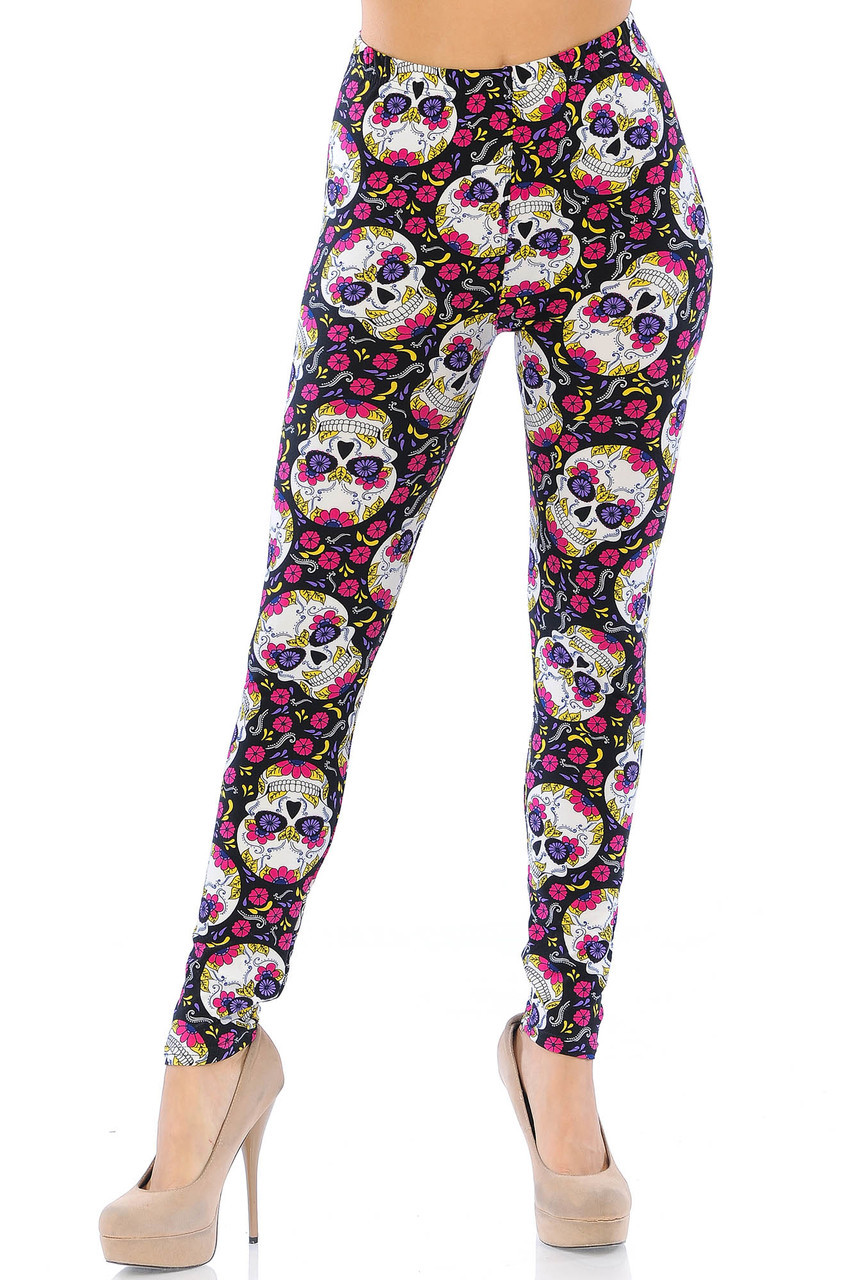 Our Buttery Soft Floral Petal Sugar Skull Leggings feature a comfort stretch elastic waist that comes up to about mid rise.