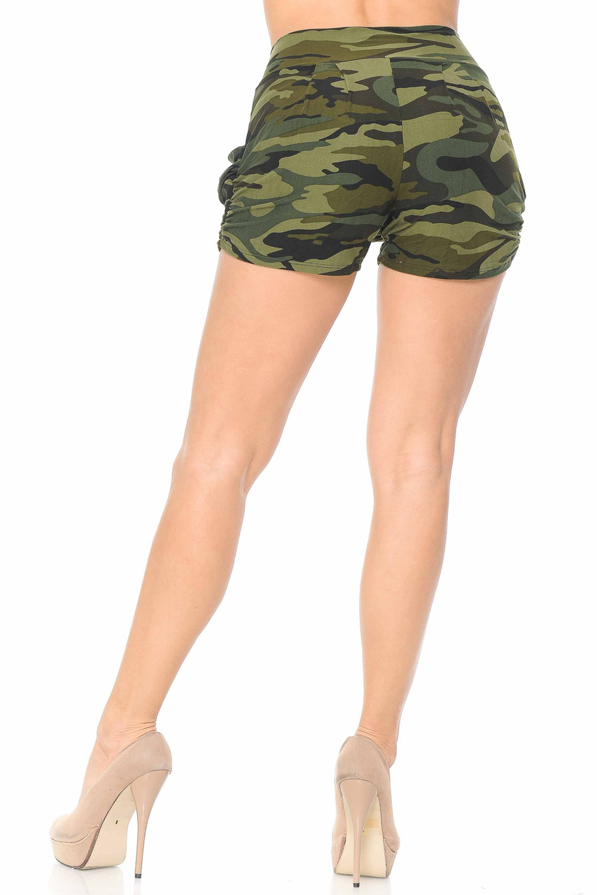 Rear view of our flattering Buttery Soft Green Camouflage Plus Size Harem Shorts that features a slightly loose fir that tapers in at the thigh hem and has a fitted high waist.