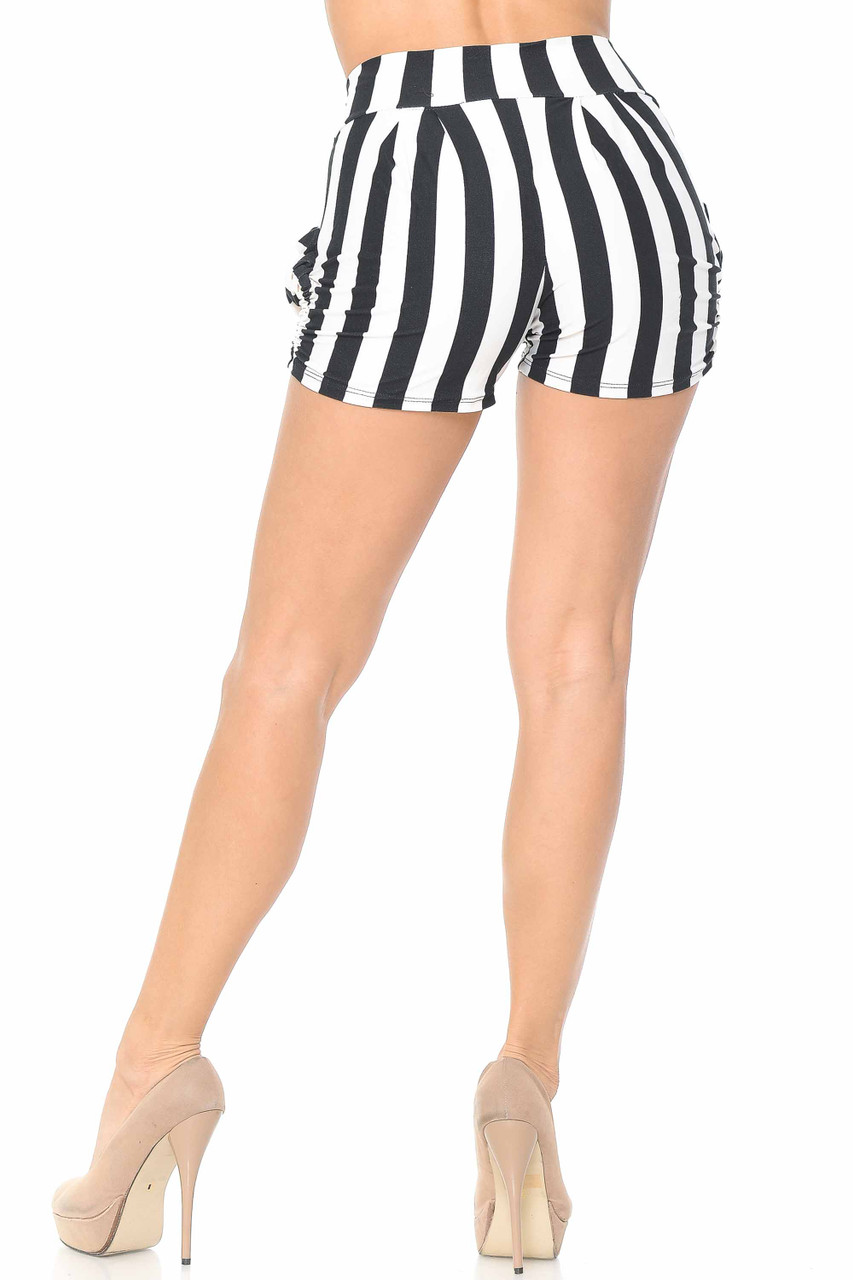 Rear view of our flattering Buttery Soft Wide Stripe Plus Size Harem Shorts that feature a trendy looser fit cut that tapers in at the bottom leg opening hem and has a fitted high waist.