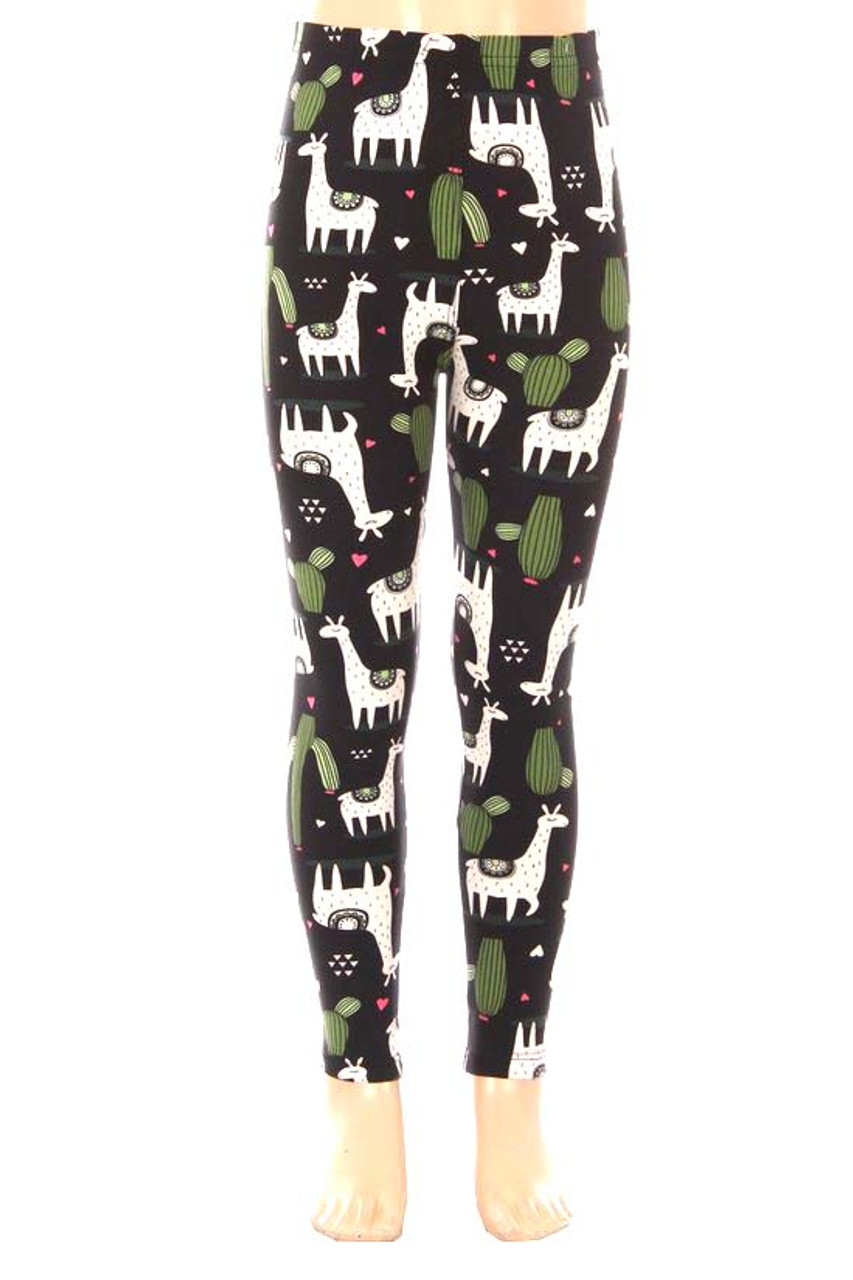 Our Buttery Soft Lama and Cactus Kids Leggings feature a cute and fun animal and cacti design on a black background with mini pink and white hearts.