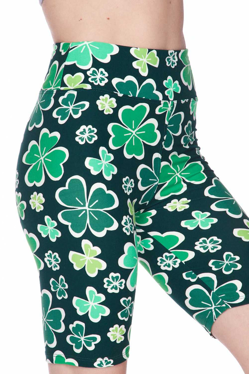 Our Buttery Soft Green Irish Clover Plus Size Shorts feature a 3 inch comfort fabric waist and a colorful green on darker green shamrock design, perfect for St. Patrick's Day.
