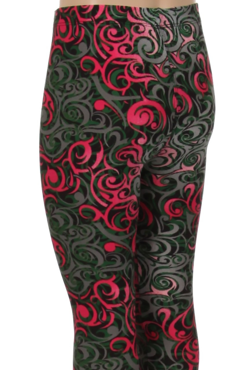 The eye-catching design on these Buttery Soft Fuchsia Tangled Swirl Kids Leggings covers every angle of this leg fashion piece.