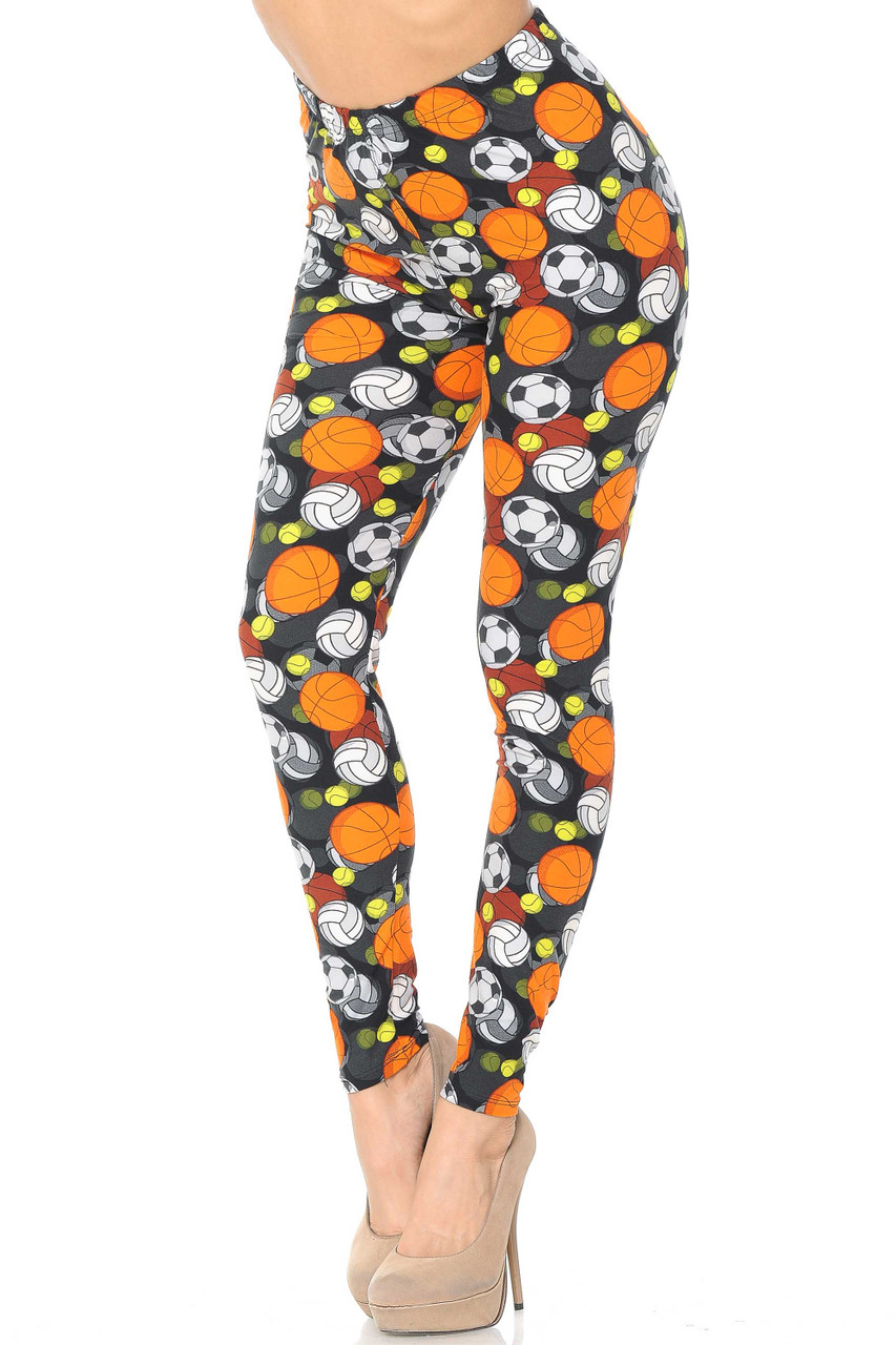 Our Buttery Soft Sports Ball Leggings feature an athletic themed look with basketballs, volleyballs, tennis balls, and soccer balls on a black background.