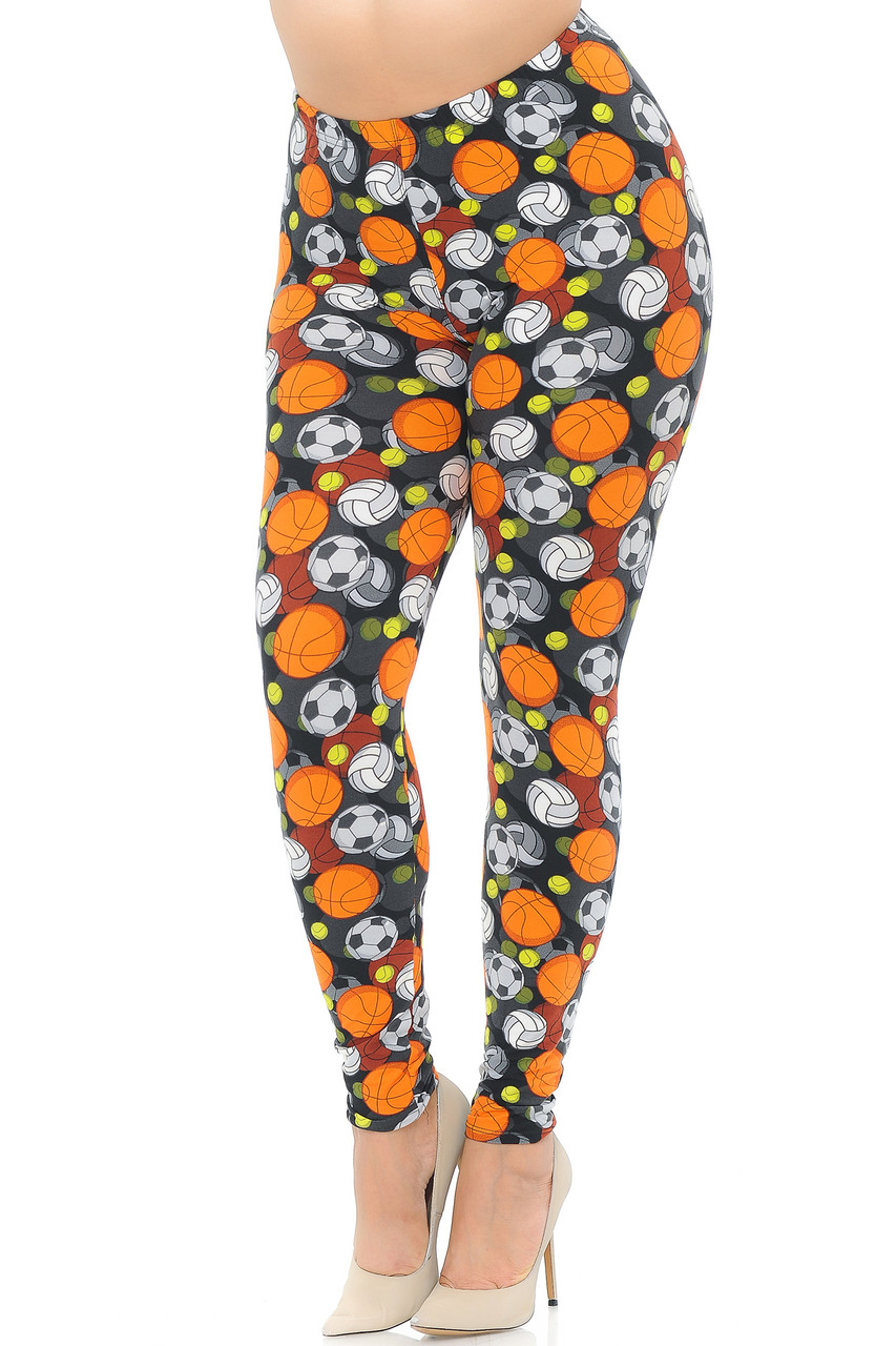 Our Buttery Soft Sports Ball Plus Size Leggings feature an athletic themed look with basketballs, volleyballs, tennis balls, and soccer balls on a black background.