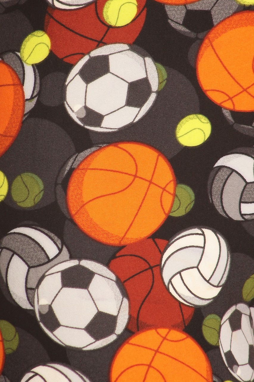 Close up of the athletic themed print on our Buttery Soft Sports Ball Extra Plus Size Leggings - 3X-5X