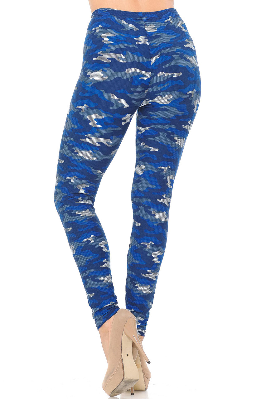 Our Buttery Soft Blue Grid Camouflage Plus Size Capris feature a skinny leg full length cut.