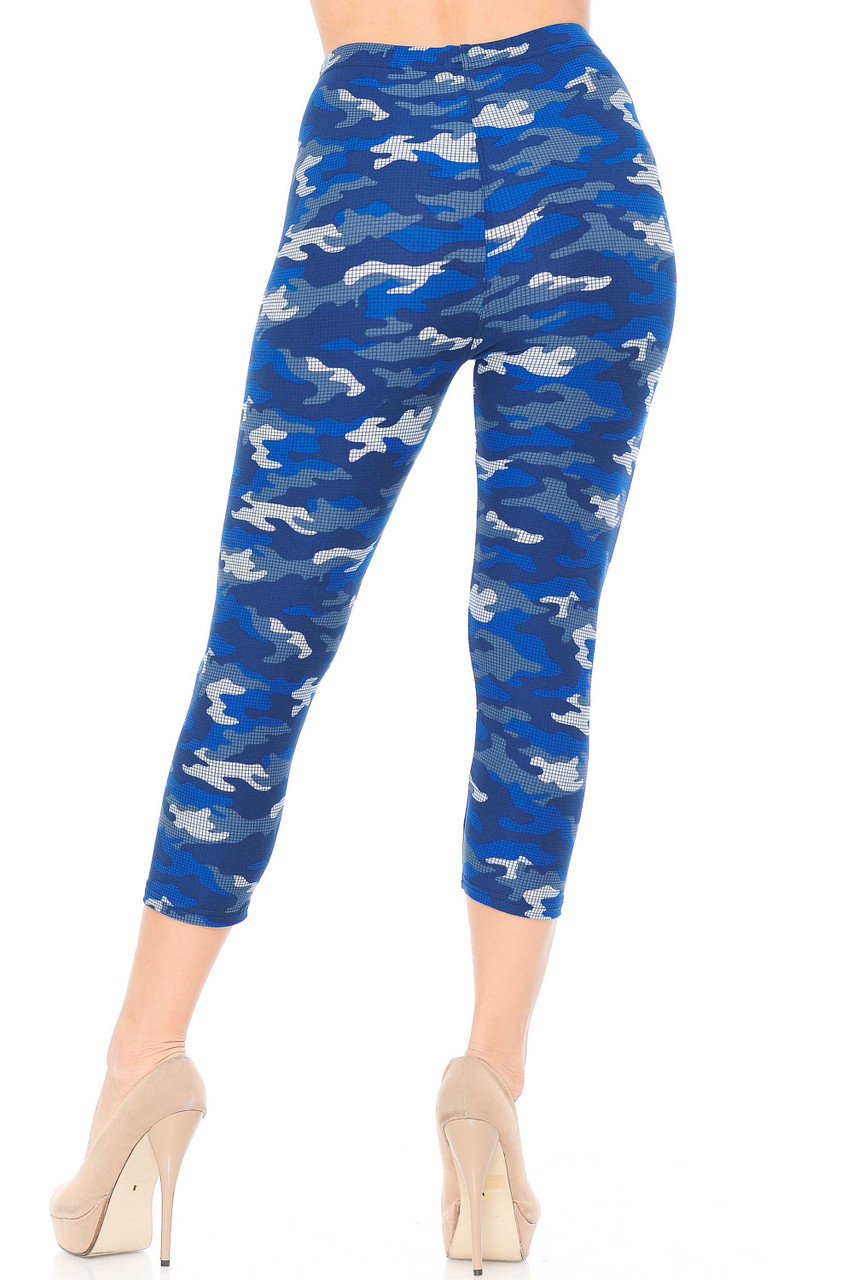 Our Buttery Soft Blue Grid Camouflage Plus Size Capris feature a comfort elastic stretch waistband and come up to about mid rise.