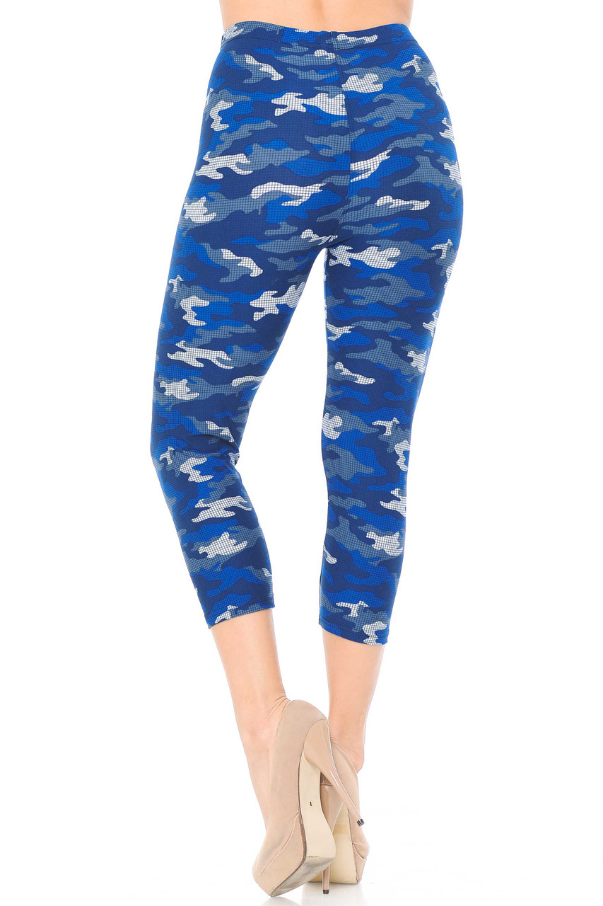 Our Buttery Soft Blue Grid Camouflage Capris feature a fitted skinny leg cut.