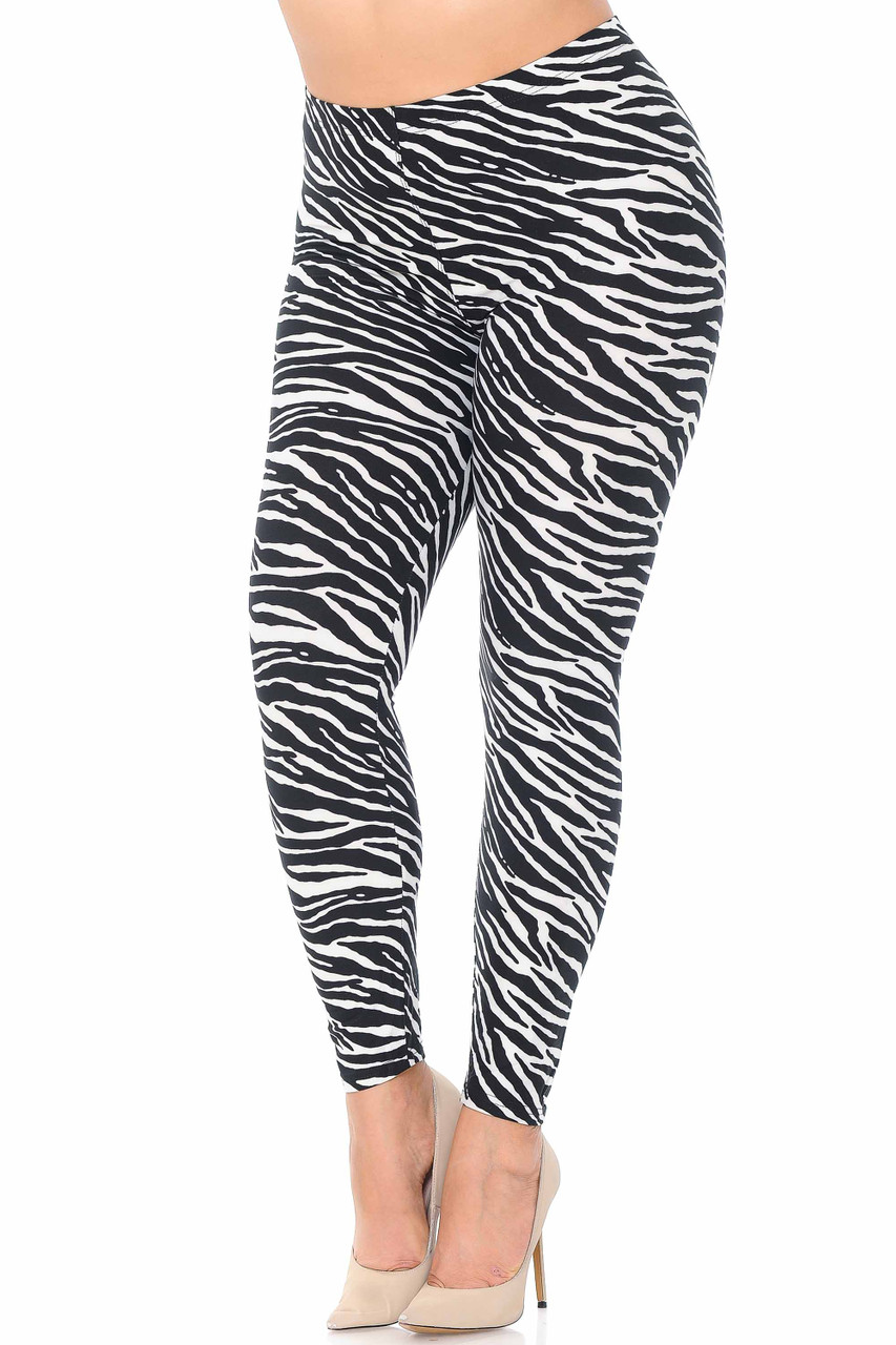 Our Buttery Soft Zebra Plus Size Leggings feature an all over black and white striped animal print design.