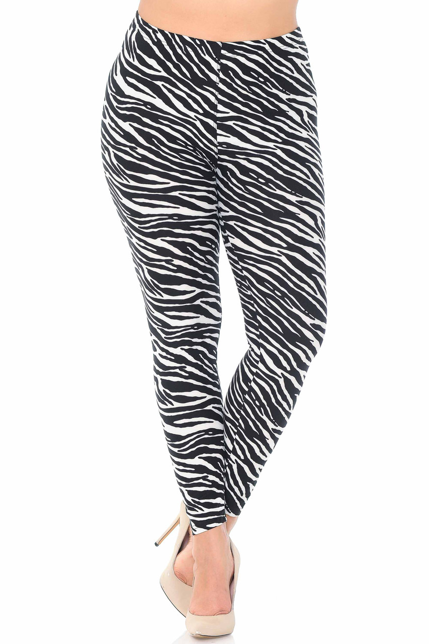Our Buttery Soft Zebra Plus Size Leggings feature an elastic waistband that comes up to about mid rise.