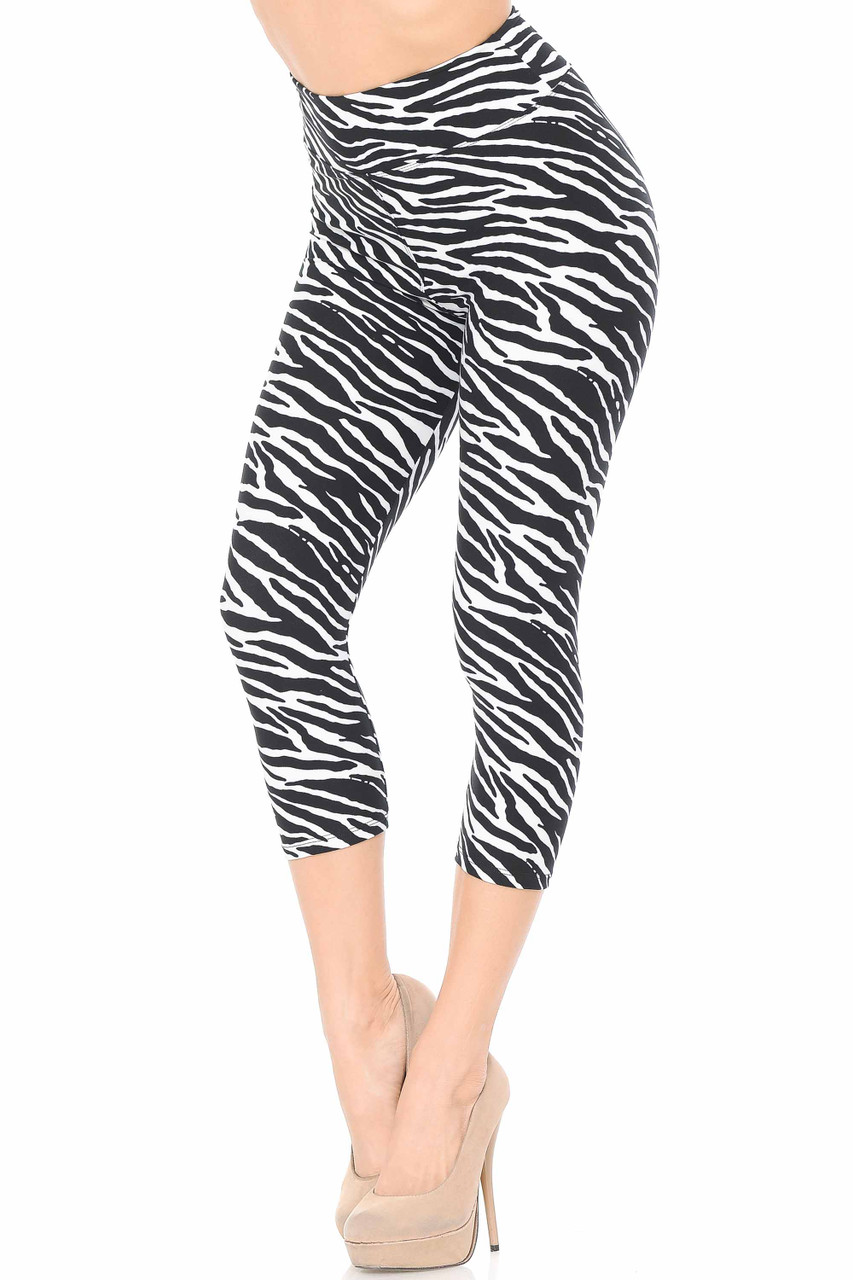 Our cropped mid calf length Buttery Soft Zebra Print Capris feature a 3 Inch waistband and a sassy all over black and white striped animal print design.