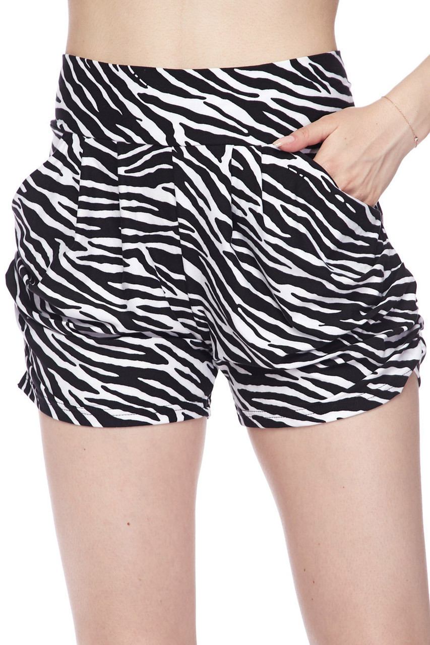 Our Buttery Soft Zebra Print Harem Shorts feature a sassy all over black and white striped animal print design.