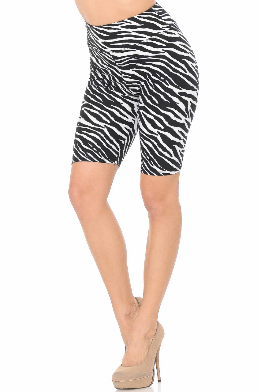 Our Buttery Soft Zebra Print Shorts  feature a 3 inch waistband and a sassy all over black and white striped animal print design.