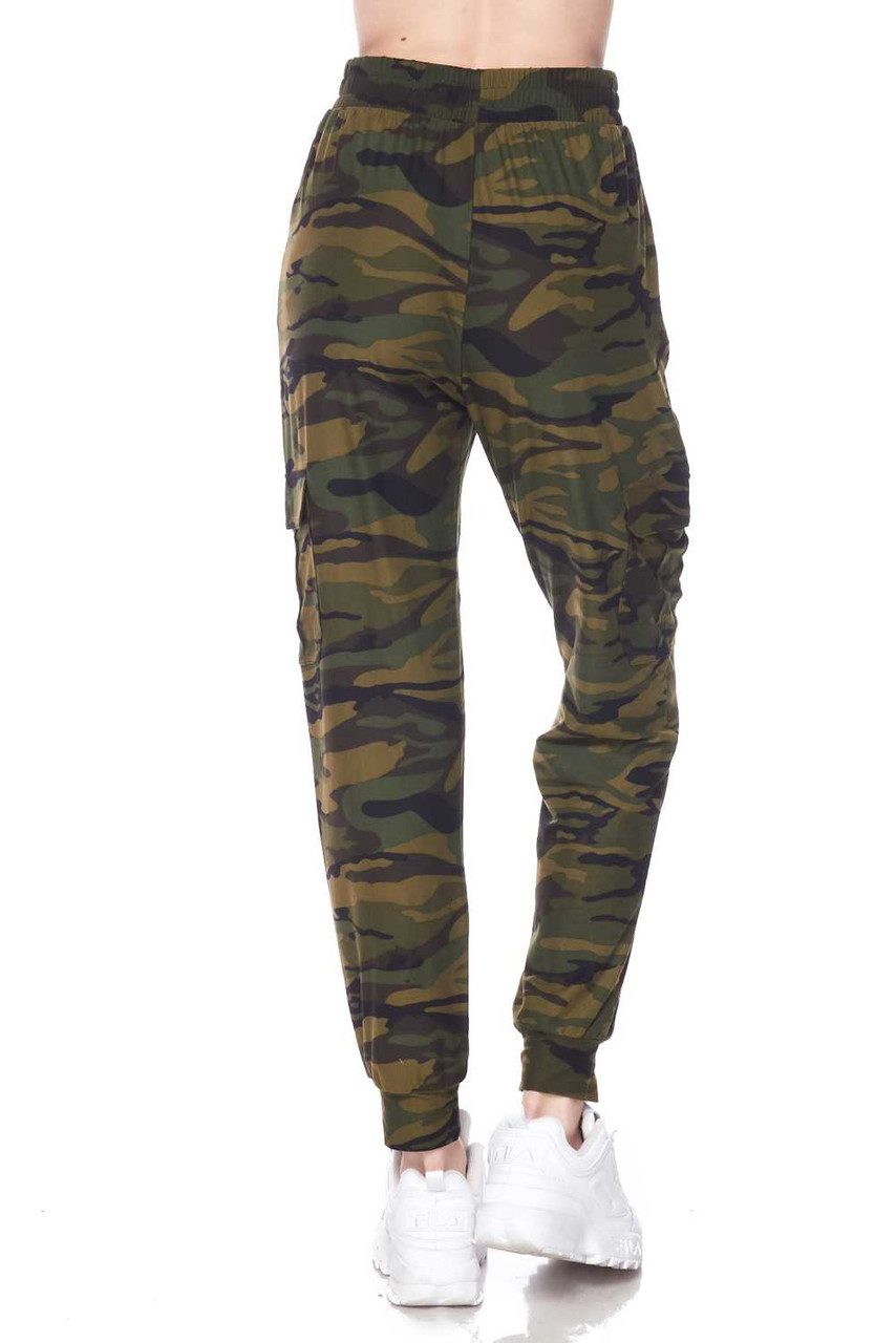 Rear view of our Buttery Soft Green Camouflage Plus Size Joggers, showcasing a loose fit leg wit tapered ankle cuffs.