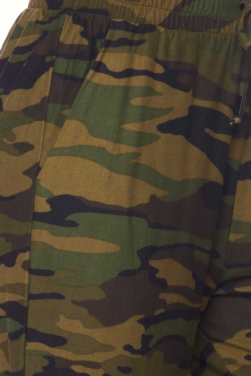 Close up swatch of the traditional olive and brown camo print on our Buttery Soft Green Camouflage Plus Size Joggers
