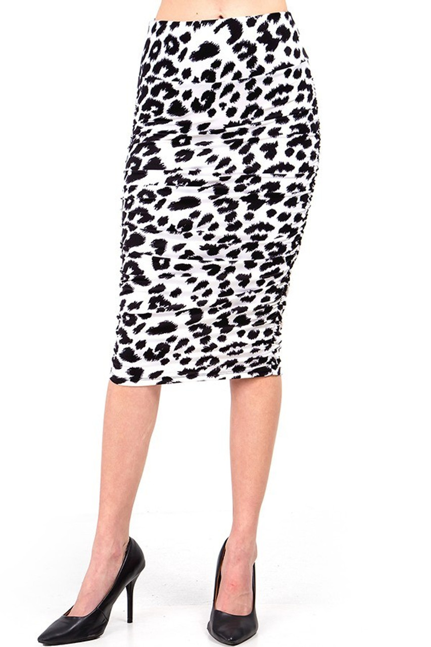 Our Buttery Soft Ivory Spotted Leopard Skirt features a below the knee hem.