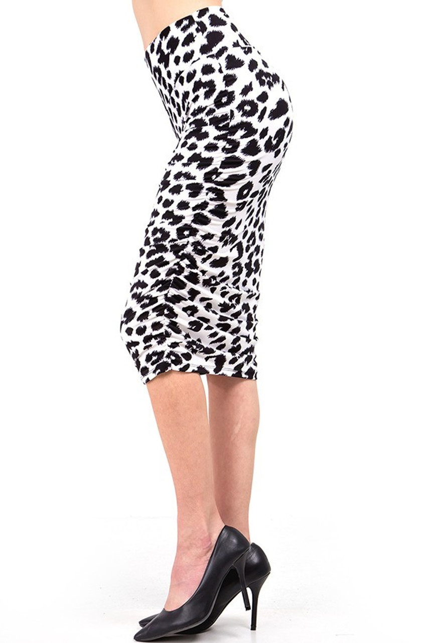 Left side view of our Buttery Soft Ivory Spotted Leopard Skirt showcasing ruched side seam detailing.