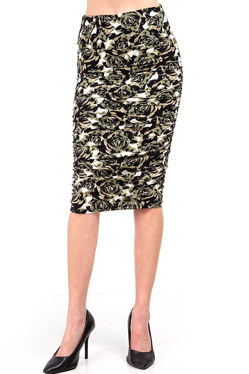 Our Buttery Soft Olive Rose Skirt features a below the knee hem.