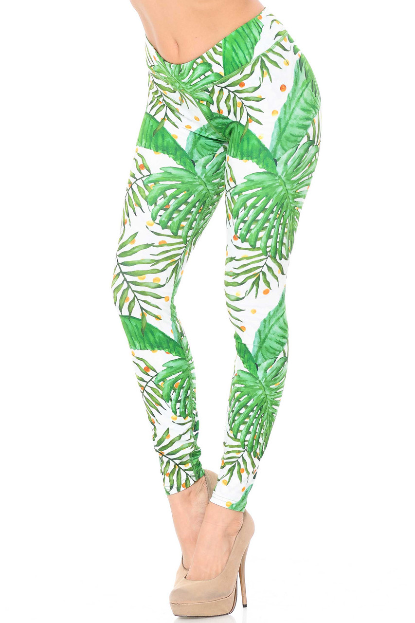 Our Double Brushed Tropical Green Palm Leaf Leggings with a 3 Inch Waistband feature a gorgeous colorful tropical frond design in a mix of kelly green and jade on a white background.