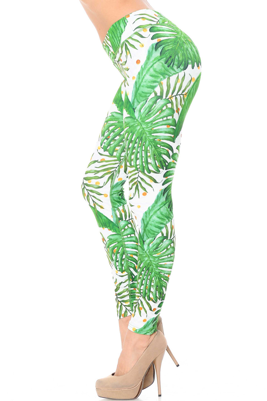 Left side view of out colorful Double Brushed Tropical Green Palm Leaf Leggings - 3 Inch Waistband.