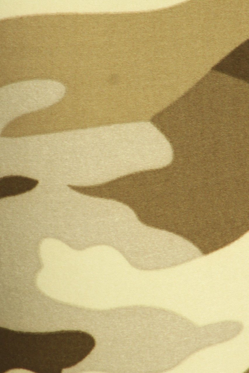 Close up swatch of Buttery Soft Light Olive Camouflage High Waisted Leggings with muted green tones.
