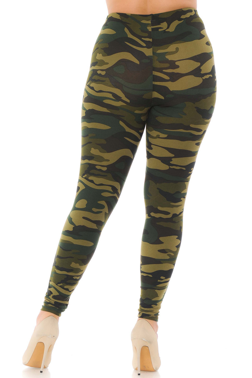 Rear view of plus size camouflage leggings with a mixed green color scheme.