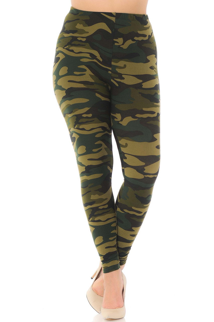 Rotated front view of mixed green colored army print leggings.