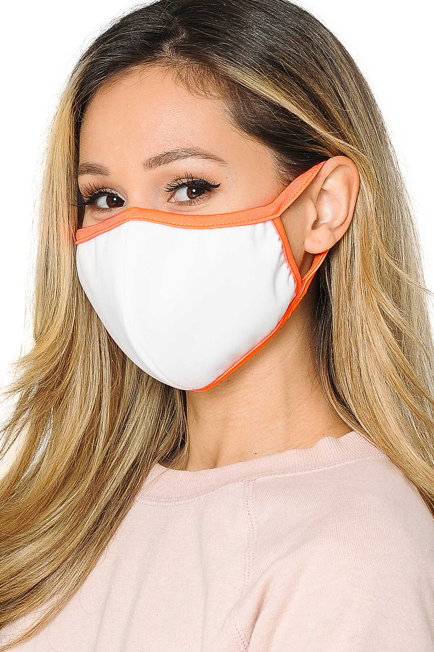 Mid side view of  Reusable 2 Ply Cotton Inner Silky Scuba Outer Female Size Face Mask in white with orange piping detail.