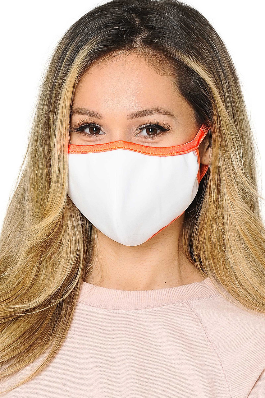 Front view of  Reusable 2 Ply Cotton Inner Silky Scuba Outer Female Size Face Mask in white with orange piping detail.