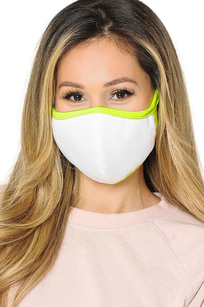 Front view of  Reusable 2 Ply Cotton Inner Silky Scuba Outer Female Size Face Mask in white with neon yellow piping detail.