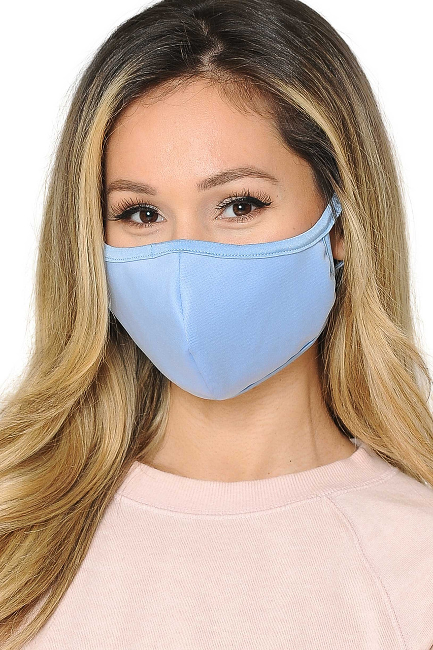 Front view of  Reusable 2 Ply Cotton Inner Silky Scuba Outer Female Size Face Mask in light blue.
