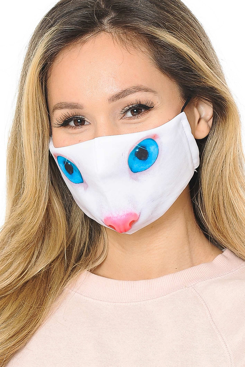 Our cute and soft fabric Blue Eye Kitty Cat Graphic Print Fashion Face Mask features a kitty nose and eyes design.