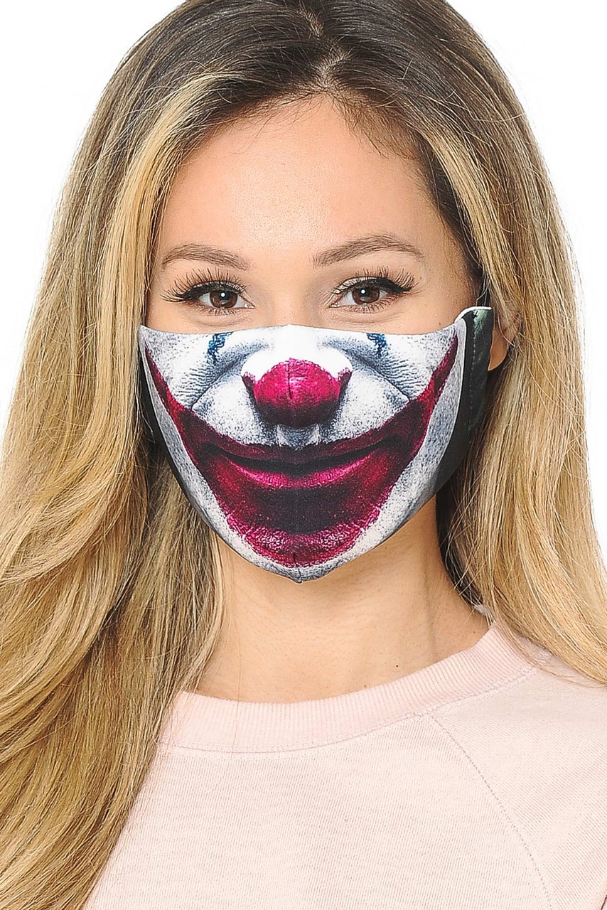Front facing view of our Joker Graphic Print Face Mask featuring a supervillain  mouth an nose design.