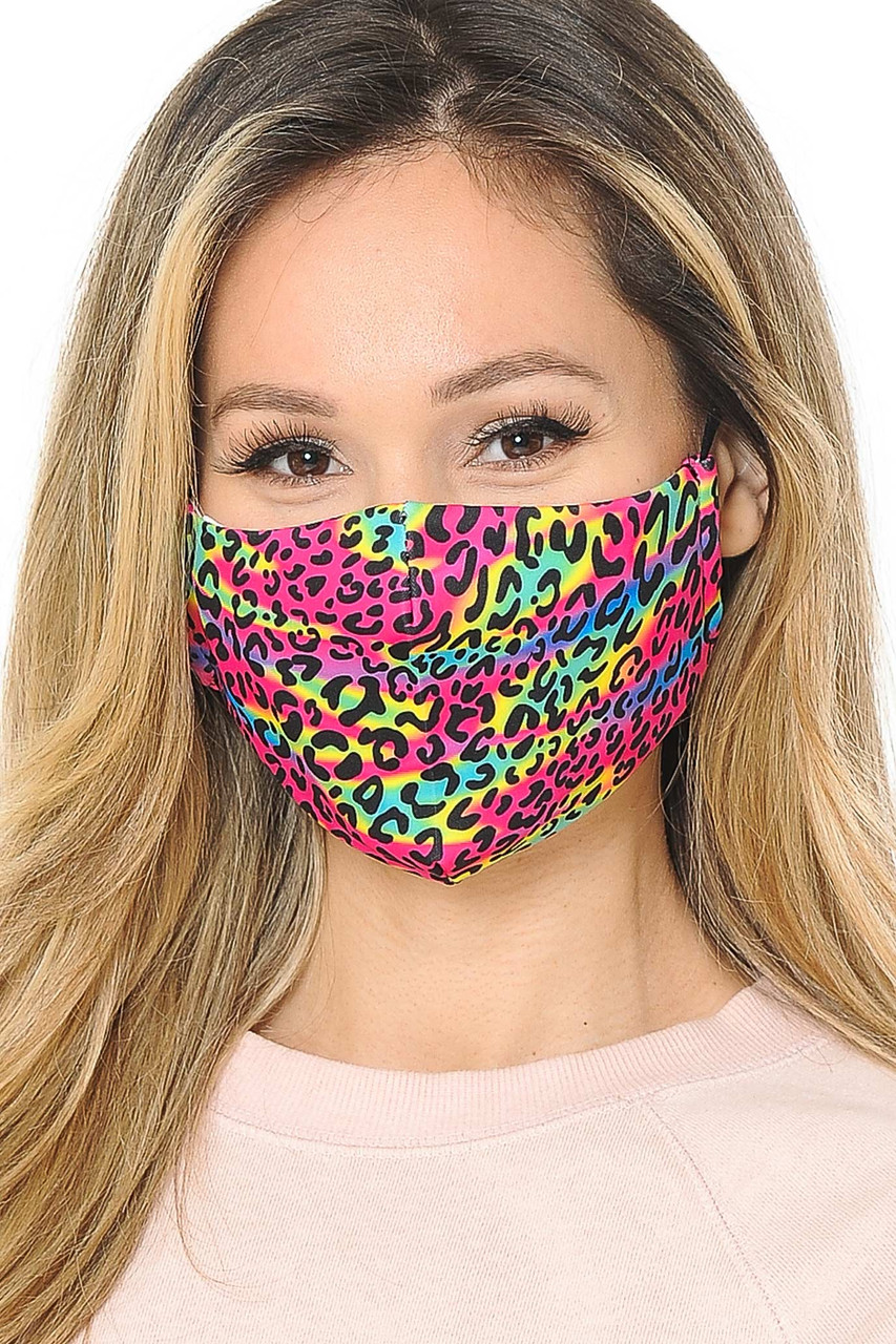 Our soft fabric Rainbow Leopard Graphic Print Face Mask combines sassy colorful style and comfort.